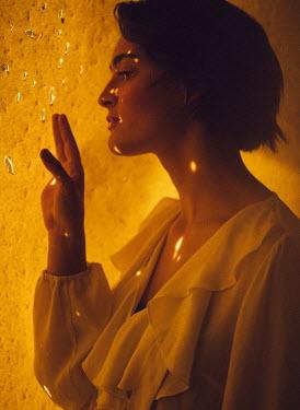 Marta Syrko WOMAN IN PROFILE BY GOLDEN WALL Women
