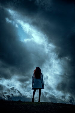 Nic Skerten GIRL OUTDOORS WITH STORMY SKY FROM BEHIND Women