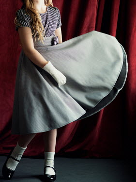 Elisabeth Ansley YOUNG GIRL DANCING IN RETRO DRESS AND GLOVES Children