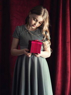 Elisabeth Ansley YOUNG GIRL HOLDING RED GIFT BOX Children