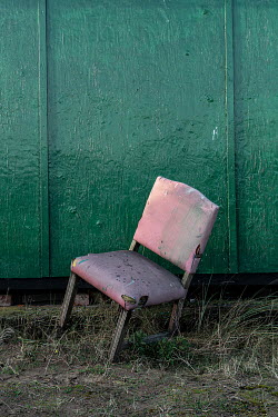 John Race WEATHERED CHAIR OUTSIDE BUILDING Miscellaneous Objects