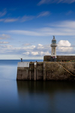 Maggie McCall LIGHTHOUSE IN HARBOUR BY CALM SEA Miscellaneous Buildings