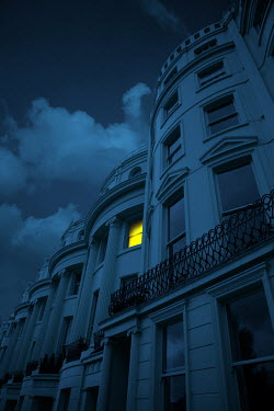 Magdalena Russocka light in window of luxury townhouse at night