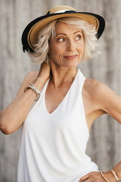 Nina Masic HAPPY MATURE WOMAN HOLDING HAT OUTDOORS Old People