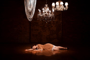 Ranat Renee WOMAN LYING ON FLOOR WITH CHANDELIERS Women