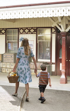 Stephen Mulcahey RETRO MOTHER AND CHILD ENTERING TRAIN STATION Children