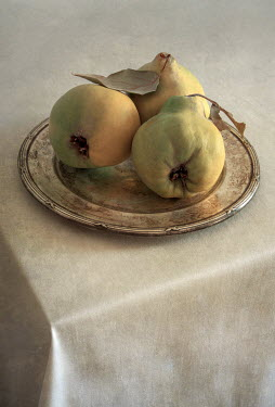 Jaroslaw Blaminsky THREE PEARS ON SILVER PLATE ON TABLE Miscellaneous Objects