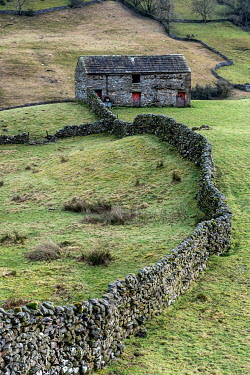 John Race OLD STONE BUILDING WITH WALL IN COUNTRYSIDE Houses