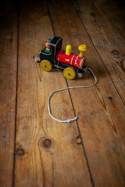 Sally Mundy TOY TRAIN WITH STRING ON WOODEN FLOOR Miscellaneous Objects