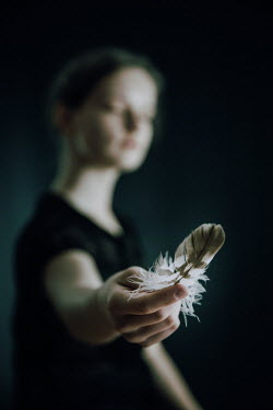 Natasza Fiedotjew CLOSE UP OF HAND OF GIRL HOLDING FEATHER Children