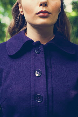Marie Carr Buttons on woman's purple coat