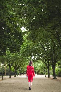 Marie Carr Woman in red dress walking in park