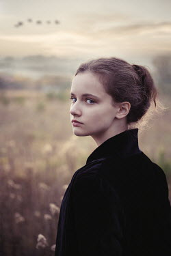 Natasza Fiedotjew Young girl wearing black jacket in countryside at sunset