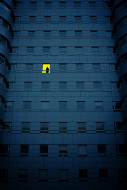 Magdalena Russocka silhouette of man in window of modern building at night