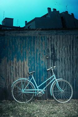 Magdalena Russocka vintage bike leaning against metallic shed