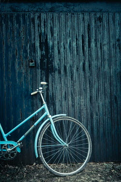 Magdalena Russocka vintage bike leaning against metallic shed