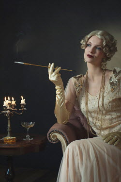Ysbrand Cosijn Young woman in 1920s dress holding cigarette holder