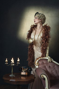 Ysbrand Cosijn Young woman in 1920s dress with feather boa and champagne glass