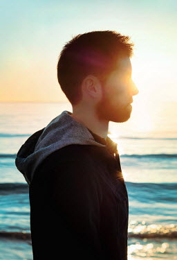Giada Piras Profile of young man on beach at sunset