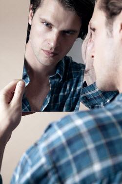 Miguel Sobreira Man Reflected in Mirror