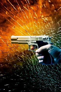 Valentino Sani Man's hand holding pistol by broken window