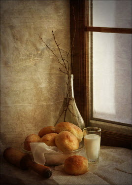Andreeva Svoboda Bread rolls and glass of milk on windowsill