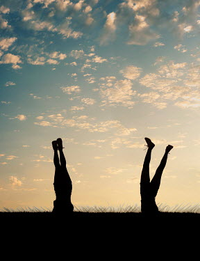 Elisabeth Ansley Silhouette of legs of girls doing handstands