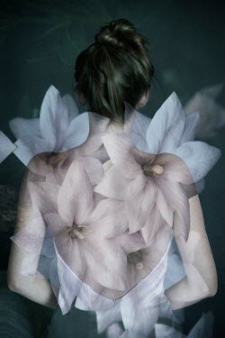 Erika Masterson Double exposure of woman from behind and flowers