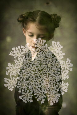 Erika Masterson Double exposure of girl's portrait and flowers