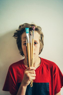 Katya Evdokimova Boy holding paintbrushes