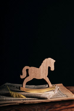 Magdalena Wasiczek wooden rocking horse and old newspapers