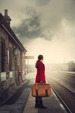 Magdalena Russocka woman with suitcase standing on old railway station