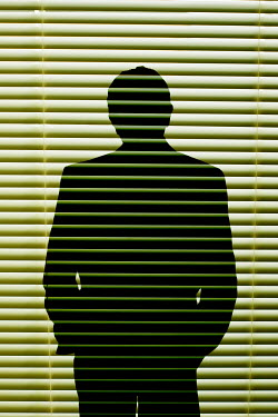 Valentino Sani Shadow of man with hands in pockets on blinds