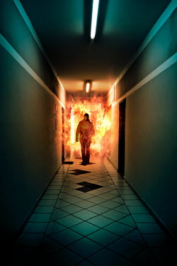 Valentino Sani Silhouette of man walking in corridor with flames