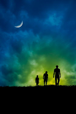 Valentino Sani Silhouette of man and boys walking on hill at night