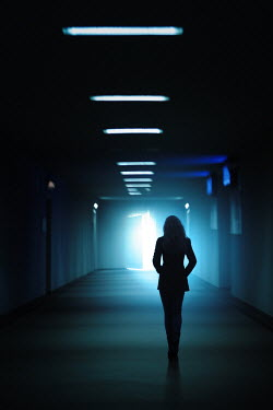 Magdalena Russocka woman walking through underground passage