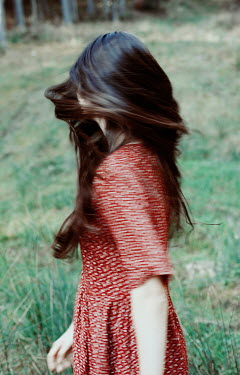 Felicia Simion Young woman in red dress turning in field Women