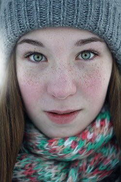 Dmitriy Bilous Teenage girl in woolly hat and scarf