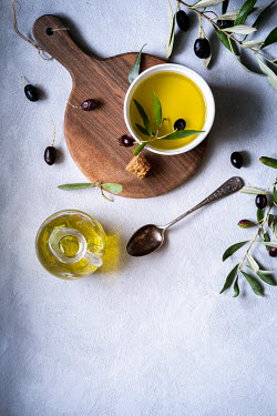 Galya Ivanova Olives and olive oil with cutting board