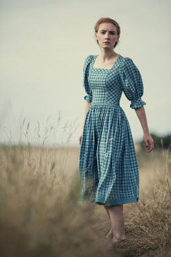 Magdalena Russocka woman in gingham dress walking in countryside