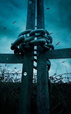 Stephen Mulcahey Chain wrapped around iron gate
