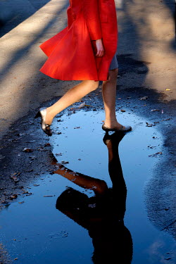 Ute Klaphake Legs of woman running through puddle