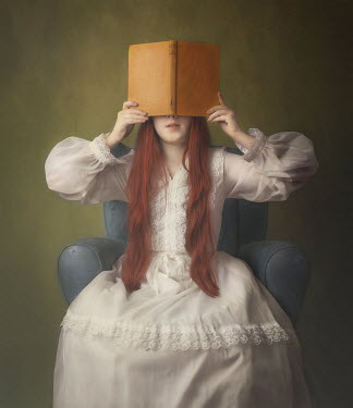 Anna Buczek Girl in white dress covering face with book