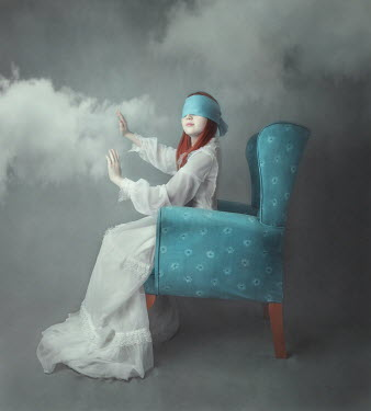Anna Buczek Blindfolded girl touching clouds
