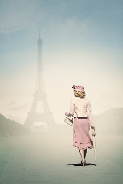 Magdalena Russocka Young woman walking to eiffel tower