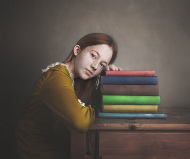 Anna Buczek Girl leaning on pile of books
