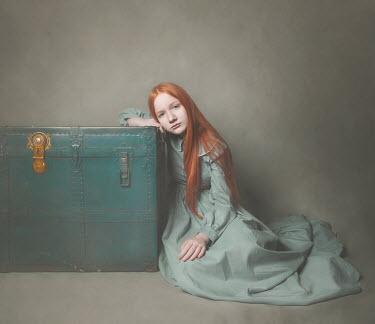 Anna Buczek Girl sitting by trunk