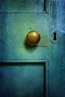Magdalena Russocka Old green door with knob and keyhole