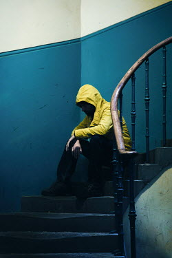 Natasza Fiedotjew Man in yellow rain coat sitting on stairs