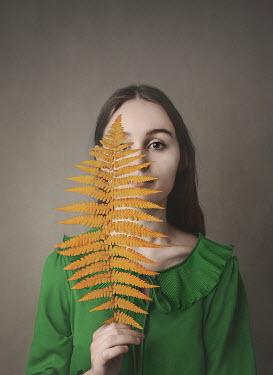 Anna Buczek Teenage girl holding fern